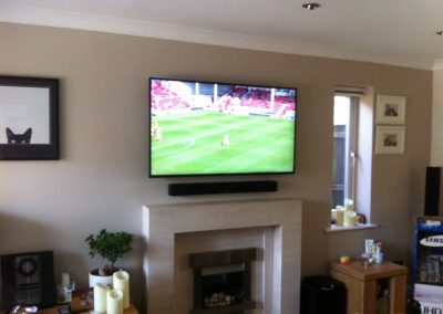 TV-and-sound-bar-installation-in-the-living-room