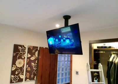 tv-mounted-on-a-sanus-ceiling-mount